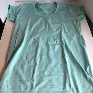 Mint green Lululemon workout top